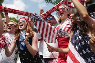 WASHINGTON, DC - JUNE 26: Fan cheer after hearing the news that Team USA will advance to the next round of the World Cup after watching the US v Germany World Cup match in Dupont Circle park June 26, 2014 in Washington, United States. (Photo by Chip Somodevilla/Getty Images)