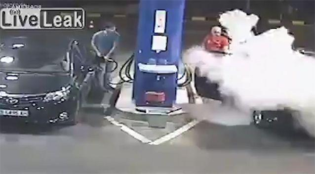 The man is sprayed by a fire extinguisher. Source: LiveLeak