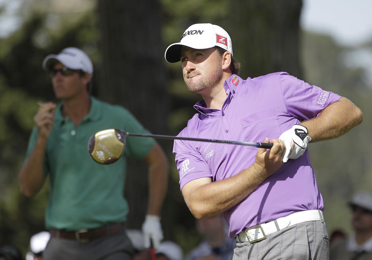 Graeme McDowell, of Northern Ireland, watches his drive on the 11th hole during the third round of the U.S. Open Championship golf tournament Saturday, June 16, 2012, at The Olympic Club in San Francisco. (AP Photo/Ben Margot)