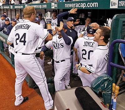 Dan Johnson is greeted after hitting the second of two homers during Rays' win
