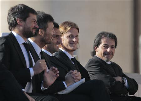 Members of Argentine soccer team San Lorenzo attend Pope Francis' Wednesday general audience in Saint Peter's square at the Vatican December 18, 2013. REUTERS/Tony Gentile
