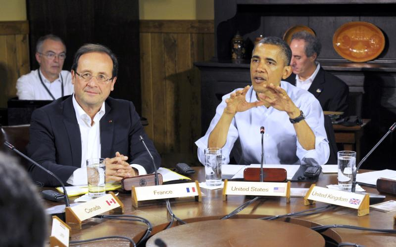 French President Francois Hollande, left, listens as U.S. President Barack Obama speaks at the start of the first working session of the G8 Summit at Camp David, Md., Saturday May 19, 2012. (AP Photo/Philippe Wojazer, Pool)