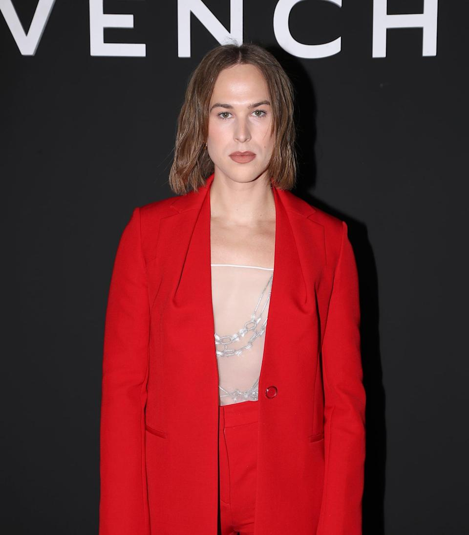 <p>She layered a sheer top and silver jewelry under the blazer.</p>
