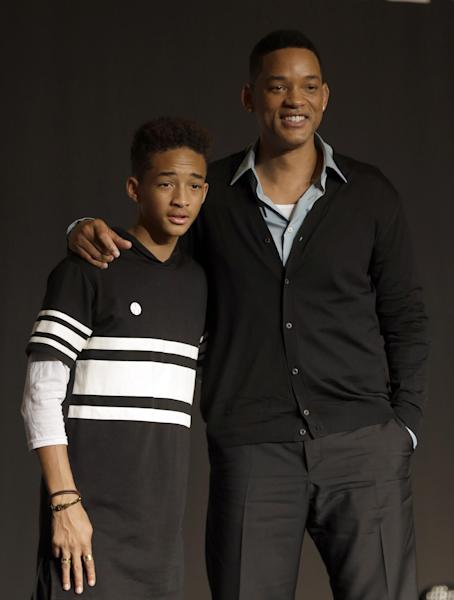 """FILE - In this May 7, 2013 file photo, U.S. actor Will Smith and his son Jaden pose for the media after press conference for their film """"After Earth"""" in Seoul, South Korea. Both actors were awarded Razzies for the film. Jaden was selected as worst actor for his role in the sci-fi flop about a father and son stranded on an untamed earth, while the elder Smith was chosen as worst supporting actor at the Golden Raspberry Awards, on Saturday, March 1, 2014, which lampoons Hollywood's awards season on the eve of the Oscars. (AP Photo/Lee Jin-man, file)"""