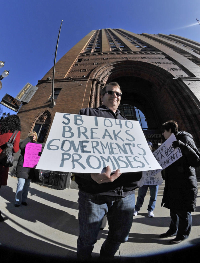 A teacher from Grand Rapids, who refused to give me his name, holds a misspelled sign outside a Senate Appropriations retirement subcommittee meeting Wednesday, April 11, 2012 in Lansing, Mich. (AP Photo/Detroit News, Dale G. Young)  DETROIT FREE PRESS OUT; HUFFINGTON POST OUT
