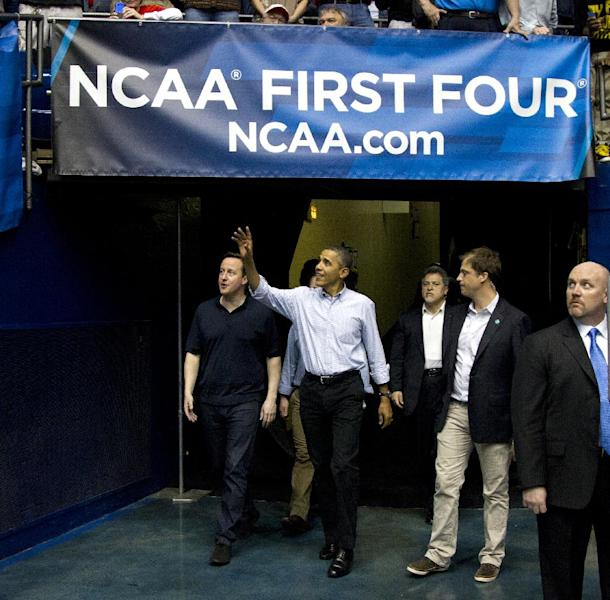 President Barack Obama and Britain's Prime Minister David Cameron arrive attend for the second half of the Mississippi Valley State versus Western Kentucky first round NCAA tournament basketball game, Tuesday, March 13, 2012, at University of Dayton Arena, in Dayton, Ohio. (AP Photo/Carolyn Kaster)