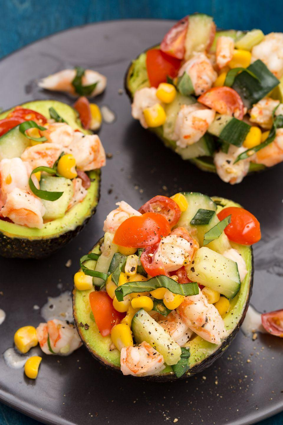 """<p>For a salty punch, top these babies off with crumbled feta. You deserve it.</p><p>Get the recipe from <a href=""""https://www.delish.com/cooking/recipe-ideas/recipes/a47066/shrimp-salad-stuffed-avocado-recipe/"""" rel=""""nofollow noopener"""" target=""""_blank"""" data-ylk=""""slk:Delish"""" class=""""link rapid-noclick-resp"""">Delish</a>.</p>"""