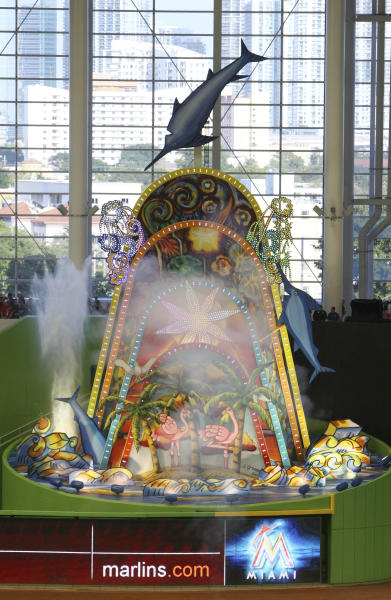 Water shoots out of a home-run sculpture in center field before the Opening Day baseball game between the Miami Marlins and the St. Louis Cardinals, Wednesday, April 4, 2012, in Miami. (AP Photo/Wilfredo Lee)