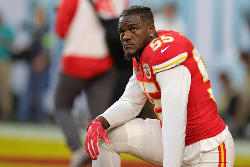 Frank Clark of the Kansas City Chiefs knees before in Super Bowl LIV at Hard Rock Stadium on February 02, 2020, in Miami, Florida.