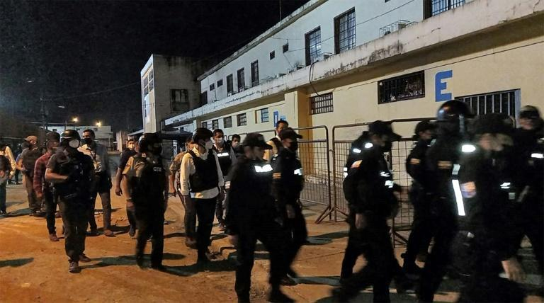 Police take part in an operation to retake control of the prison in Guayaquil where a riot left more than 100 inmates dead -- the picture was provided by Ecuador's national police (AFP/-)