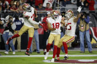 San Francisco 49ers wide receiver Dante Pettis (18) celebrates his touchdown against the Arizona Cardinals with wide receiver Emmanuel Sanders (17) and tight end George Kittle (85) during the second half of an NFL football game, Thursday, Oct. 31, 2019, in Glendale, Ariz. (AP Photo/Rick Scuteri)