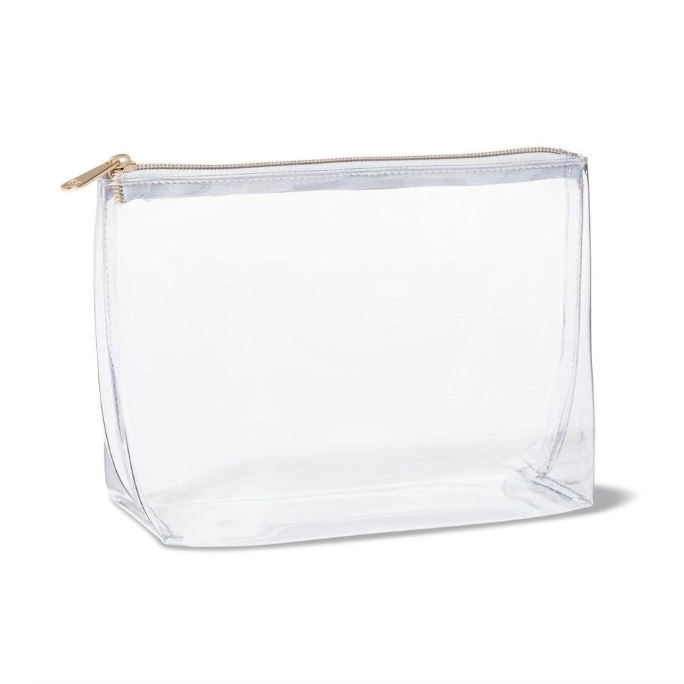 """$9.99, Target. <a href=""""https://www.target.com/p/sonia-kashuk-8482-square-clutch-makeup-bag-clear/-/A-52702563"""">Get it now!</a>"""