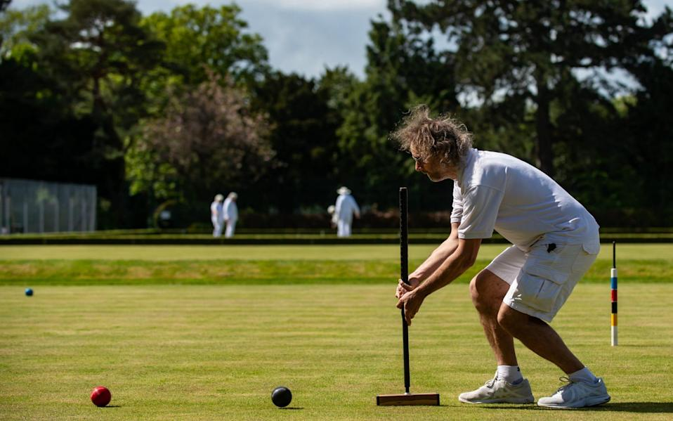 Peterborough and Northampton Croquet Clubs battle it out at Central Park, Peterborough - Adam Hughes / SWNS