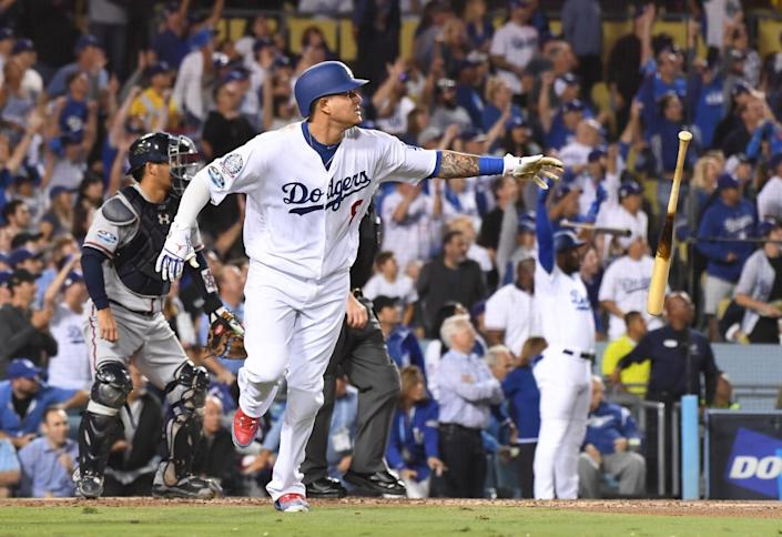 Manny Machado heads to first after hitting a home run for the Dodgers in the 2018 playoffs.