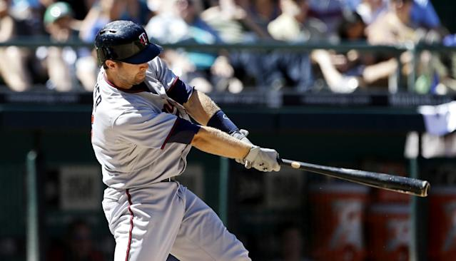 Minnesota Twins' Brian Dozier homers against the Seattle Mariners in the seventh inning of a baseball game, Saturday, July 27, 2013, in Seattle. (AP Photo/Elaine Thompson)