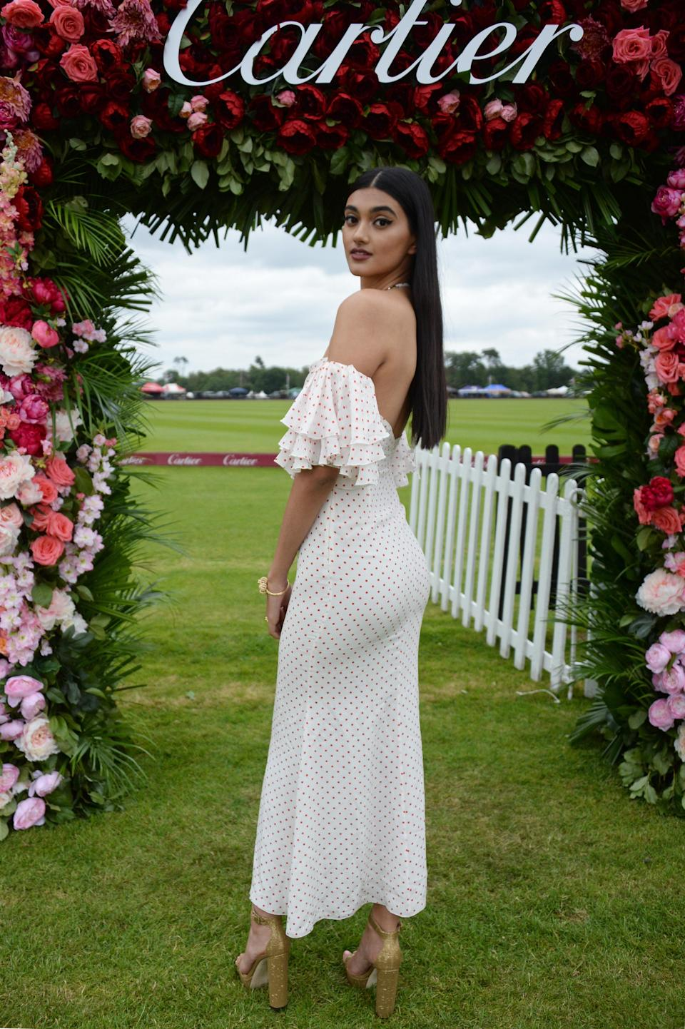 <p>Neeham Gill attended the Cartier Queen's Cup Polo at Guards Polo Club in a cold-shoulder polka dot dress. The model accessorised the look with Cartier jewels. <em>[Photo: Getty]</em> </p>