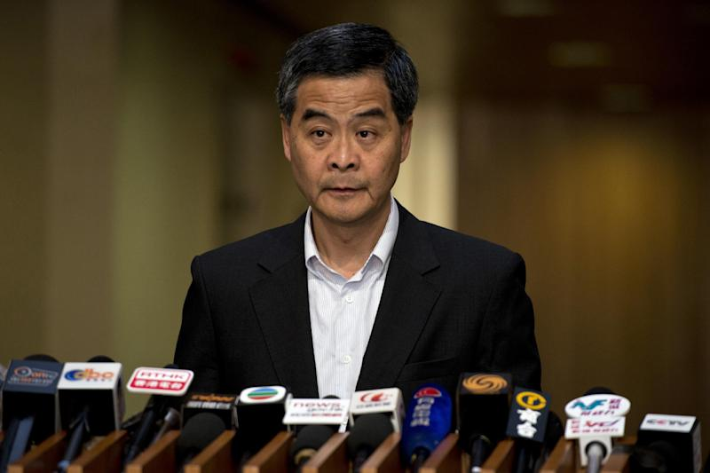 Hong Kong's Chief Executive Leung Chun-ying speaks at a press conference on political reform at the government headquarters in Hong Kong on July 19, 2014 (AFP Photo/Alex Ogle)