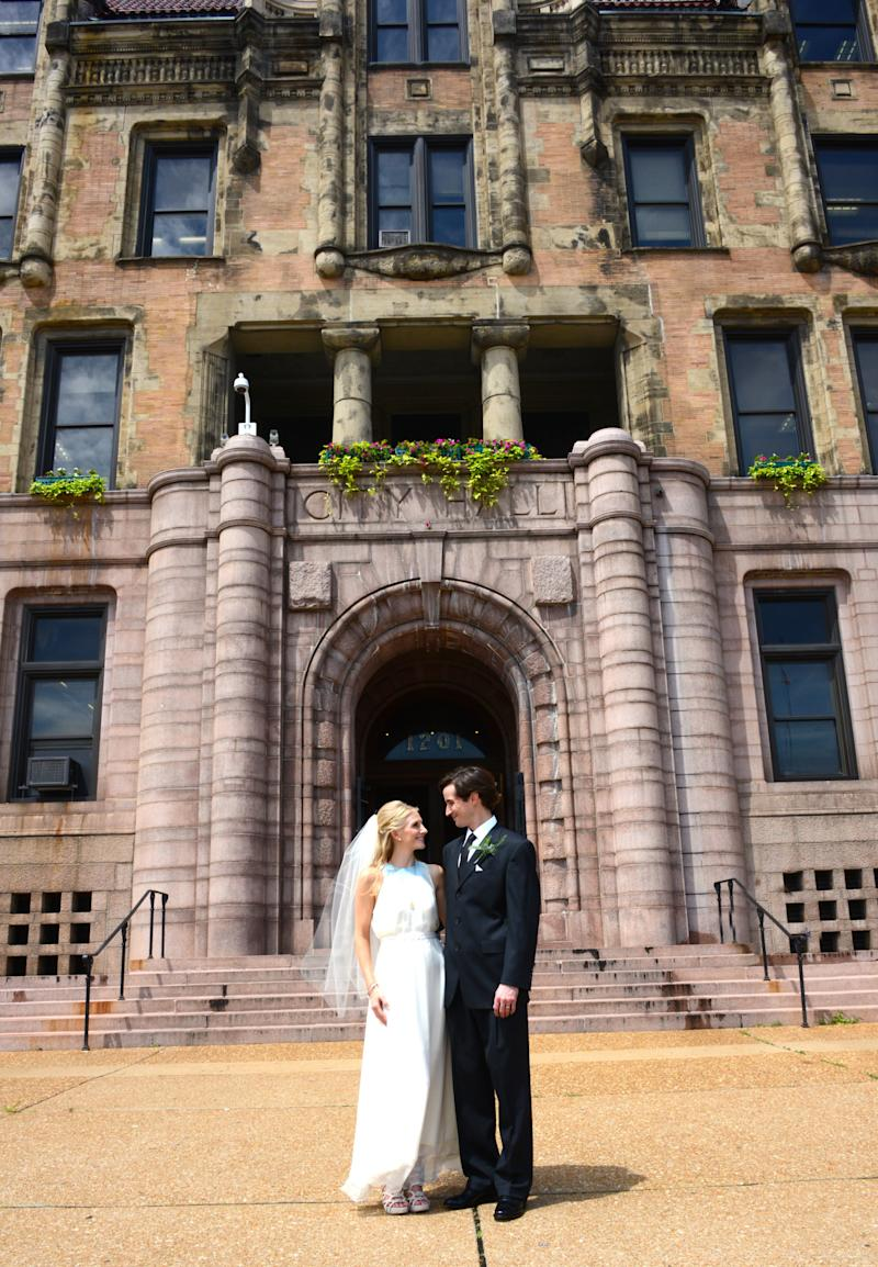 The couple standing outside St. Louis City Hall on their wedding day.  (Lawing Photography)