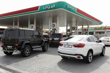 Motorists wait to fuel their vehicles with petrol at a gas station in Dubai