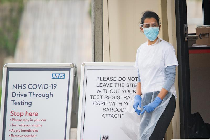 A medical worker at a drive-in coronavirus testing facility at the Chessington World of Adventures Resort in south west London, as the UK continues in lockdown to help curb the spread of the coronavirus.