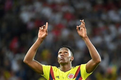 Colombia defender Yerry Mina celebrates after scoring the equalising goal against England in the World Cup last-16 in Moscow