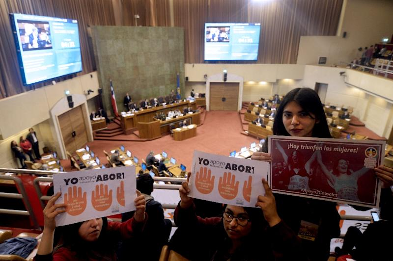 Activists participate in a pro-abortion demonstration inside Chile's National Congress on July 20, 2017