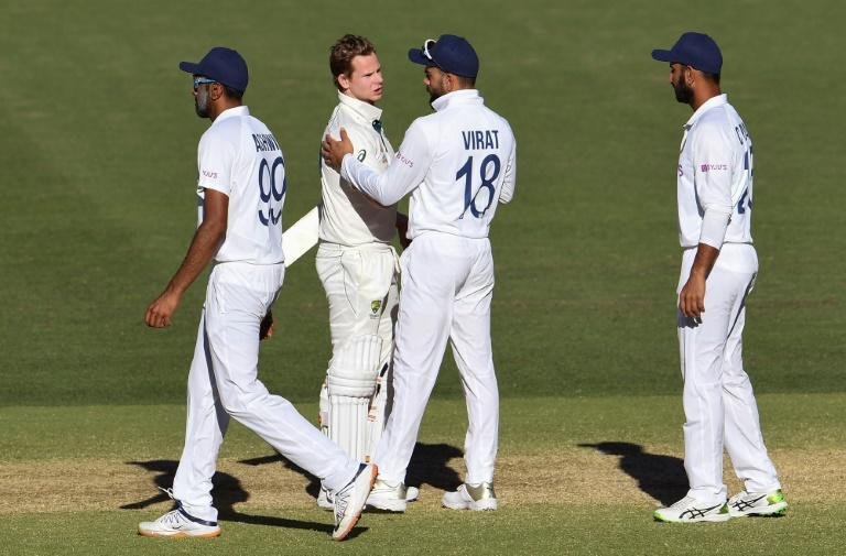 Australia's Steve Smith (second left) is congratulated by India's Virat Kohli at the end of the first Test in Adelaide which Australia won by eight wickets