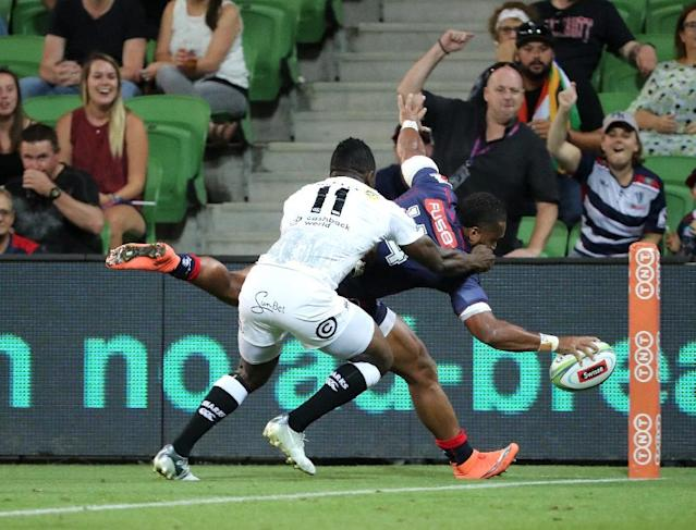 Sefa Naivalu of the Rebels scores a try during the Super Rugby union match between the Melbourne Rebels, which the Australians ended as comfortable winners (AFP Photo/MARK DADSWELL)
