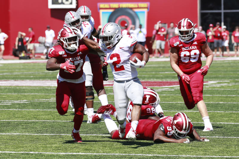 Ohio State Buckeyes running back J.K. Dobbins (2) breaks away to score a touchdown against Indiana Hoosiers defensive back Devon Matthews (27) during the second quarter at Memorial Stadium. (USAT)