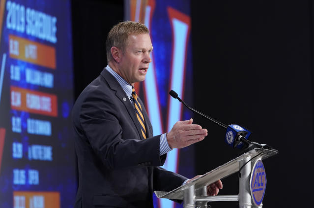 Virginia head coach Bronco Mendenhall speaks during the Atlantic Coast Conference NCAA college football media days in Charlotte, N.C., Thursday, July 18, 2019. (AP Photo/Chuck Burton)