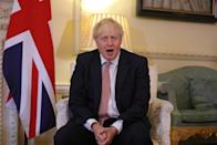 """Britain's Prime Minister Boris Johnson gestures during a meeting with Ukraine's President Volodymyr Zelensky inside number 10 Downing Street, in central London on October 8, 2020. - Britain and Ukraine will on Thursday sign a """"strategic partnership agreement"""" to support Kiev's sovereignty """"in the face of Russia's destabilising behaviour"""", Prime Minister Boris Johnson's office said. (Photo by Aaron Chown / POOL / AFP) (Photo by AARON CHOWN/POOL/AFP via Getty Images)"""