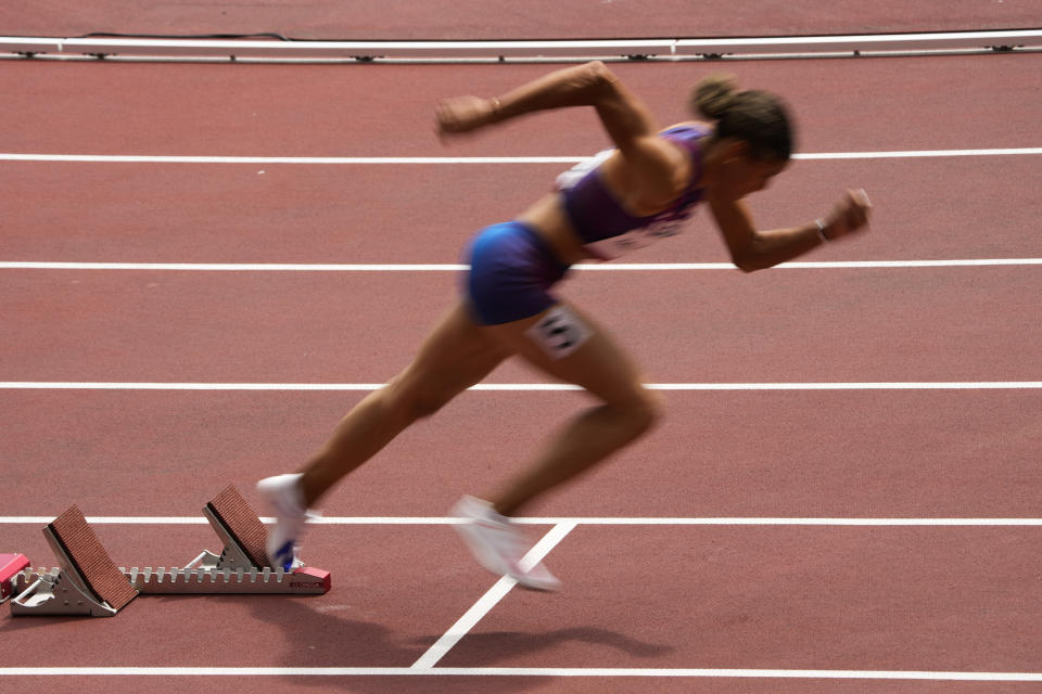 Sydney Mclaughlin, of United States, wins a heat in the women's 400-meter hurdles at the 2020 Summer Olympics, Saturday, July 31, 2021, in Tokyo. (AP Photo/Charlie Riedel)
