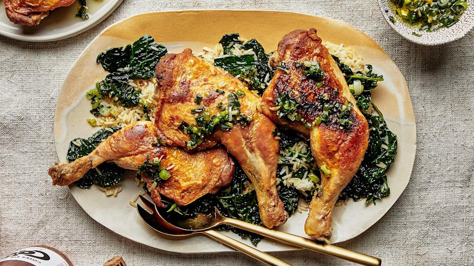 "The scallion-ginger oil served alongside the chicken and rice puts this recipe from <a href=""https://www.bonappetit.com/story/chicken-kale-rice-recipe?mbid=synd_yahoo_rss"" rel=""nofollow noopener"" target=""_blank"" data-ylk=""slk:Fancy Nancy"" class=""link rapid-noclick-resp"">Fancy Nancy</a> in Brooklyn over the top. If you aren't feeling the rice, use another cooked grain (it can even be fridge-cold and left over) and just heat until warm and beginning to crisp. This recipe can also work with any large cut of skin-on, bone-in chicken, including spatchcocked and halves. <a href=""https://www.bonappetit.com/recipe/chicken-with-schmaltzy-rice-and-kale?mbid=synd_yahoo_rss"" rel=""nofollow noopener"" target=""_blank"" data-ylk=""slk:See recipe."" class=""link rapid-noclick-resp"">See recipe.</a>"