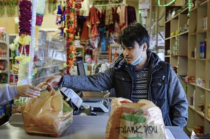 FARGO, N.D. - APRIL 13, 2021: Shankar Subba manages his family-owned Himalayan Grocery store in Fargo, N.D. Subba runs the store with his father Padam Sing Subba, and his brother Ajit.