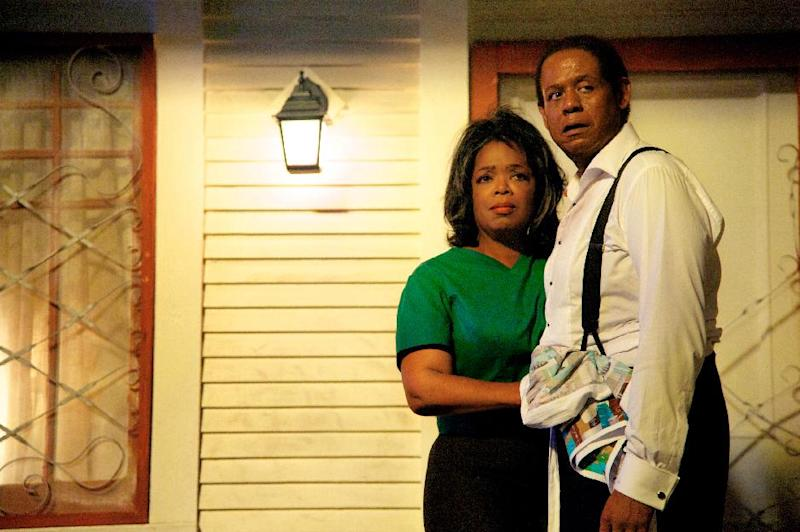 """FILE - This film image released by The Weinstein Company shows Oprah Winfrey as Gloria Gaines, left, and Forest Whitaker as Cecil Gaines in a scene from """"Lee Daniels' The Butler."""" Oprah Winfrey is paying tribute to the late Nelson Mandela at the NAACP Image Awards on Saturday, Feb. 22, 2014. """"12 Years a Slave,"""" """"Lee Daniels' The Butler,"""" """"Fruitvale Station,"""" ''Mandela: Long Walk to Freedom"""" and """"The Best Man Holiday"""" are vying for the outstanding motion picture trophy. (AP Photo/The Weinstein Company, Anne Marie Fox, file)"""