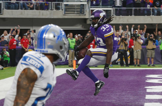 FILE - In this Oct. 1, 2017, file photo, Minnesota Vikings running back Dalvin Cook (33) celebrates after scoring on a 5-yard touchdown run during the first half of an NFL football game against the Detroit Lions in Minneapolis. Cook has made it through more than six months of his knee rehab, after a torn ACL cut short his promising rookie season with the Minnesota Vikings. He's making the most of the team's sparkling new training facility, eager to pick up in 2018 where he left off. (AP Photo/Jim Mone, File)