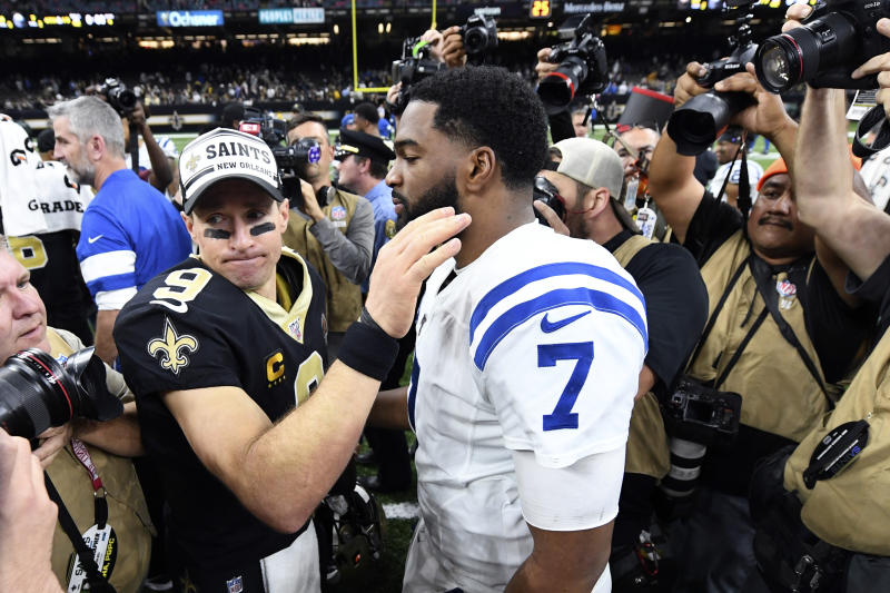 New Orleans Saints quarterback Drew Brees (9) greets Indianapolis Colts quarterback Jacoby Brissett (7) after an NFL football game in New Orleans, Monday, Dec. 16, 2019. The Siant won 34-7. (AP Photo/Bill Feig)
