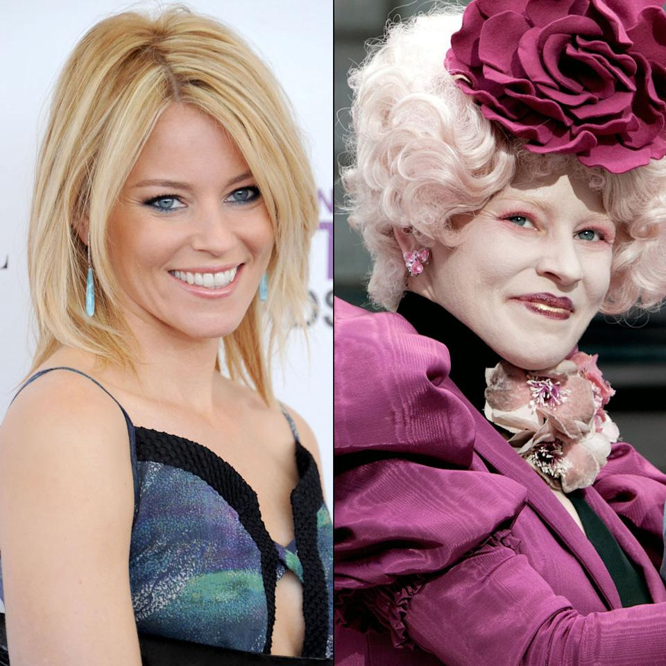"""For the role of Effie Trinket, the flamboyant coordinator who selects """"Tributes"""" to compete, Elizabeth Banks underwent a head-to-toe transformation. Head makeup artist Ve Neill told <a target=""""_blank"""" href=""""http://www.people.com/people/article/0,,20575002,00.html"""">People Magazine</a>, """"I wanted to completely blot out Elizabeth Banks's skin tone to give Effie that sort of Kabuki look."""" Then she airbrushed pink and lavender tones on top of the white base to match Effie's extravagant wigs and outfits. The process took around an hour and a half every day, but Banks told People that the most challenging aspect was her footwear. She said, """"All of my shoes were completely amazing but highly uncomfortable."""""""
