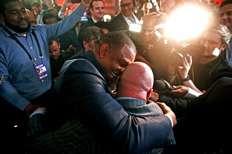 David Griffin, New Orleans Pelicans Executive Vice President of Basketball Operations, gets a hug from head coach Alvin Gentry after it was announced that their team had won the first pick during the NBA basketball draft lottery Tuesday, May 14, 2019, in Chicago. (AP Photo/Nuccio DiNuzzo)