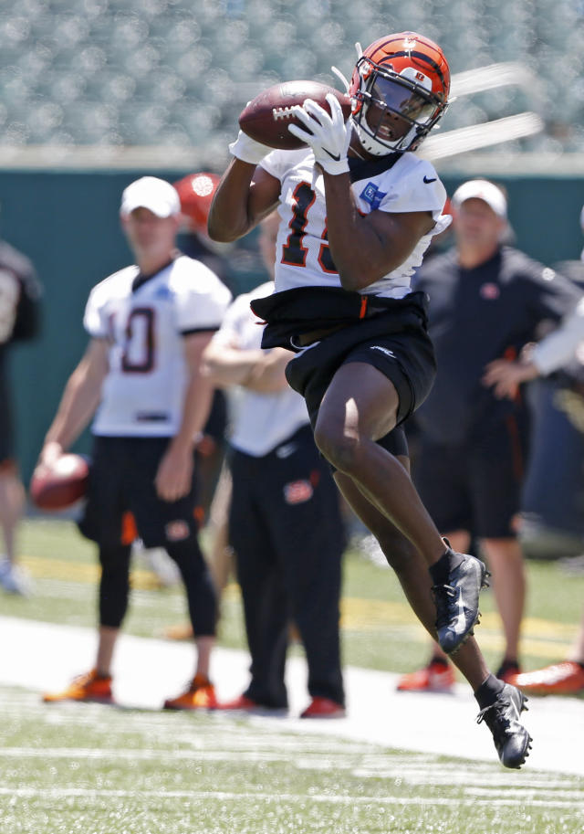 Cincinnati Bengals wide receiver AJ Green catches a pass during an NFL football practice Tuesday, June 11, 2019, in Cincinnati. (AP Photo/Gary Landers)