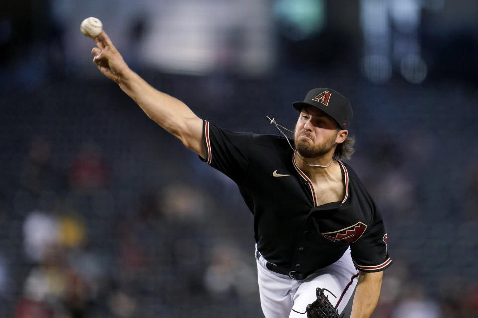 Arizona Diamondbacks starting pitcher Riley Smith throws during the first inning of the team's baseball game against the Cincinnati Reds on Saturday, April 10, 2021, in Phoenix. (AP Photo/Ross D. Franklin)