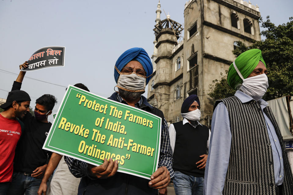 Representatives of different religions walk in a march in support of the ongoing farmers' protest, in Kolkata, India, on Dec. 12, 2020. India's prime minister Narendra Modi Friday held virtual talks with farmers from six states and asked them to explain how the government's agricultural policies have benefited them, a month after facing massive farmer protests that have rattled his administration. (AP Photo/Bikas Das)