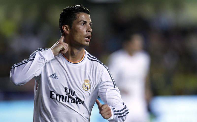 Real Madrid's Cristiano Ronaldo from Portugal celebrates after scoring against Villarreal during their La Liga soccer match at the Madrigal stadium in Villarreal, Spain, Saturday, Sept. 14, 2013. (AP Photo/Alberto Saiz)