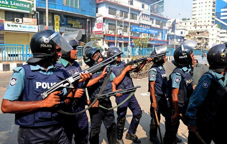 Bangladeshi police fire rubber bullets at Islamist activists during a clash in Dhaka on February 22, 2013
