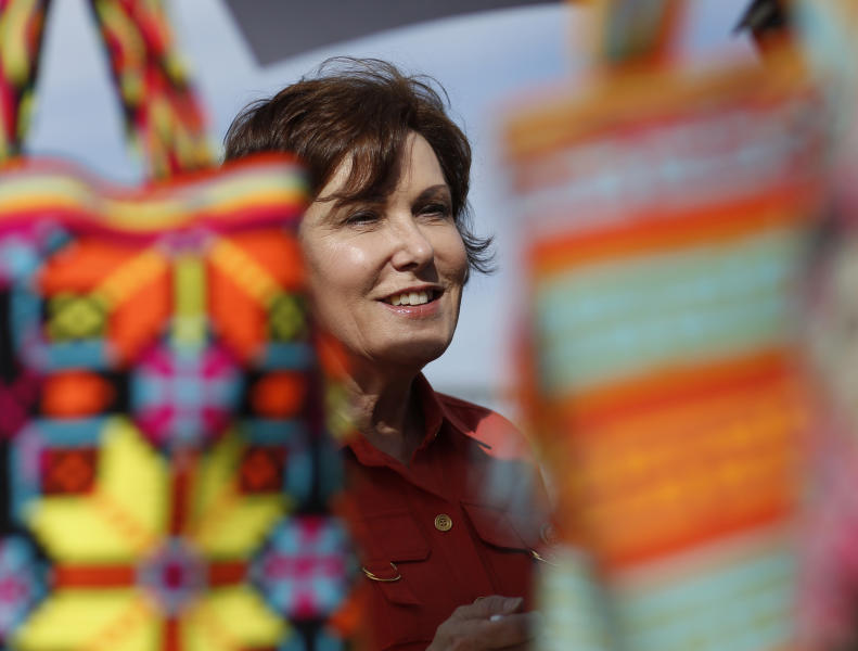 In this May 5, 2018, photo, Rep. Jacky Rosen, D-Nev., speaks with vendors at a Cinco de Mayo festival in North Las Vegas, Nev. Rosen is running for the U.S. Senate. The most closely-watched race in Nevada's primary election Tuesday, June 12, is the battle for governor. GOP Sen. Dean Heller now can expect to breeze through his primary and focus on readying for a November battle with Rosen, who is expected to easily win her party's backing Tuesday against five others. (AP Photo/John Locher)