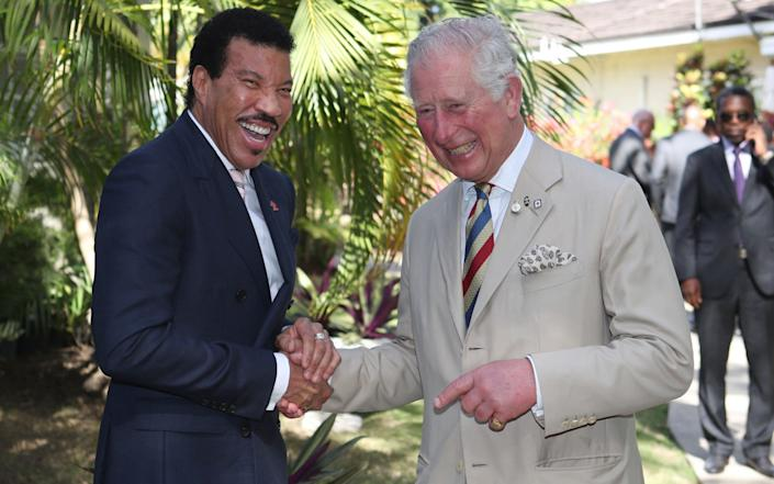 The Prince of Wales meets singer Lionel Richie at a Prince's Trust International Reception in Barbados in 2019 - PA