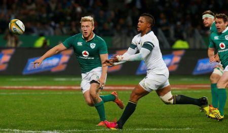 FILE PHOTO - Rugby Union - Rugby Test - Ireland v South Africa - Cape Town South Africa - 25/06/16. South Africa's Elton Jantjies passes the ball as Ireland's Stuart Olding looks on. REUTERS/Mike Hutchings Picture Supplied by Action Images