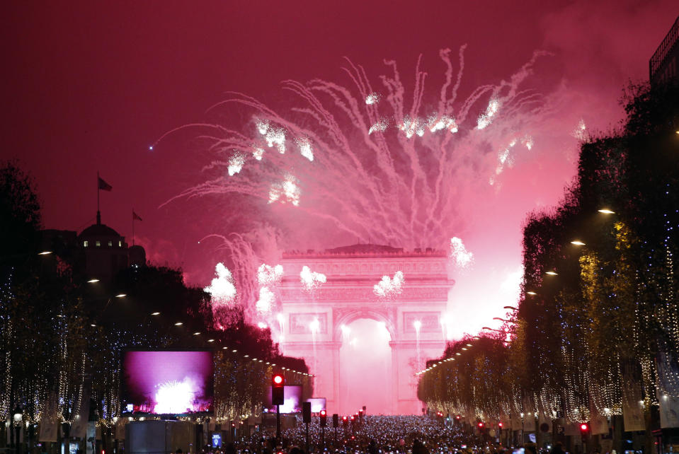 FILE - In this Jan. 1, 2017, file photo, fireworks illuminate the Arc de Triomphe during the New Year's Eve celebration on the Champs Elysees, in Paris. If ever a year's end seemed like cause for celebration, 2020 might be it. Yet the coronavirus scourge that dominated the year is also looming over New Year's festivities and forcing officials worldwide to tone them down. (AP Photo/Christophe Ena, File)