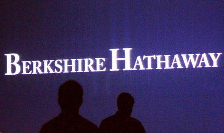 File photo of Berkshire Hathaway shareholders walking by a video screen at the company's annual meeting in Omaha