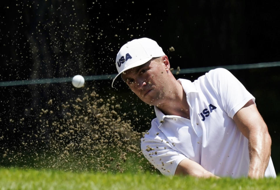 United States' Justin Thomas plays a shot from a bunker during a practice round of the men's golf event at the 2020 Summer Olympics, Tuesday, July 27, 2021, at the Kasumigaseki Country Club in Kawagoe, Japan, (AP Photo/Matt York)